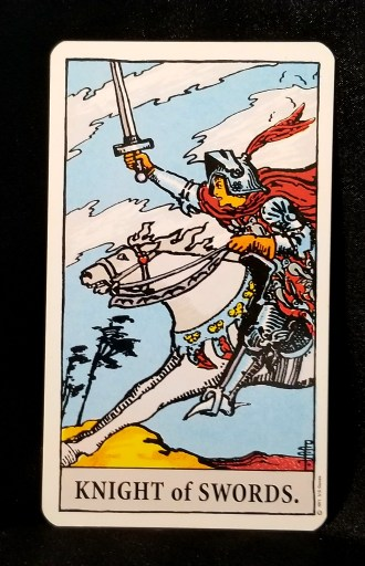 Knight of Swords - Tarot Card:  A knight riding into battle on his horse, his sword held at the ready.