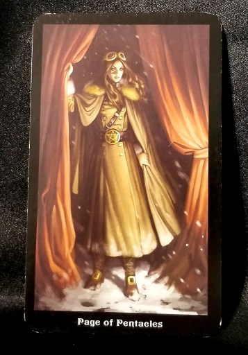 Page of Pentacles - Tarot Card:  A young woman dressed in steampunk attire steps out from behind a curtain into the snow.