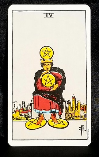 Four of Pentacles - Tarot Card:  A pentacle crowned man, holding another pentacle while both feet rest on two additional pentacles