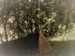 "magickal ""no-fly"" zone - A common husehold broom leaning againsts a cauldron .  Both are outdoors."
