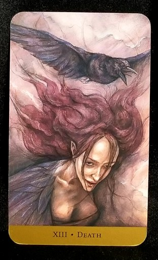 Death- A banshee flying throught the air, a crow flying above her.