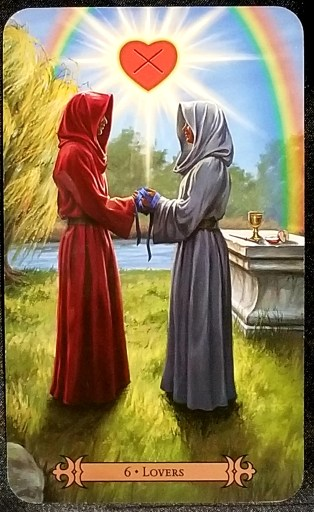 Lovers - Two robed and hooded figures, their hands warpped with ribbons, stand beneath a rainbow and heart