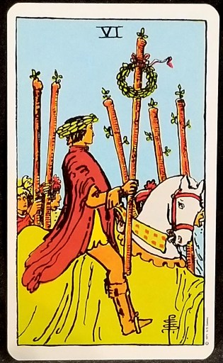 Six of Wands- A man astride a horse holidng a laureled eand.  Five foot soldiers walk next to him.