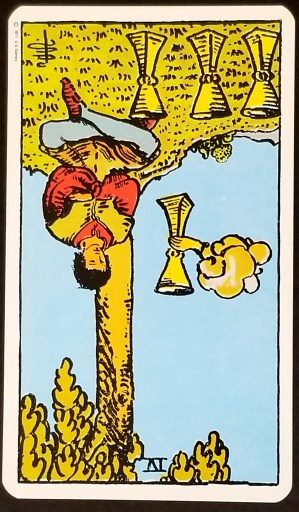 Four of Cups, REversed - A man sitting under a tree looking sad. The cardis upside down