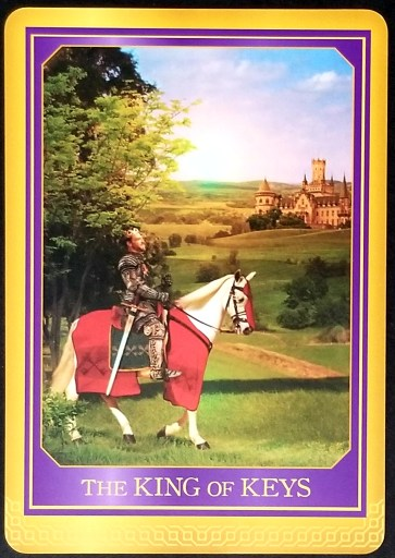 The King of Keys: A king sitting astride a white horse looking towards a castle