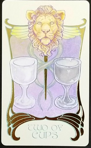Two of Cups- Tarot:  A lion's head atop a caduceus which rests between two cups