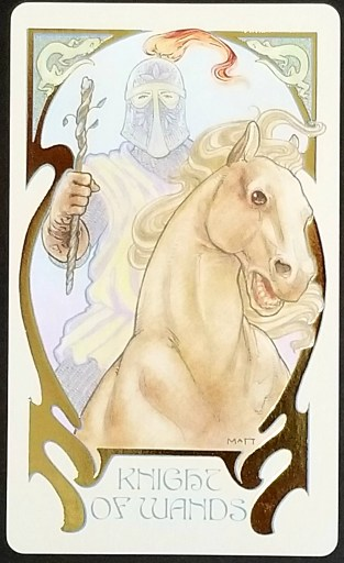 Knight of Wands- Tarot Card:  A knight carrying a twisted wand sits atop a golden horse.