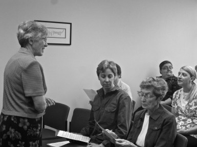 Sr. Agatha leads Sisters and volunteers in choir practice for Mass