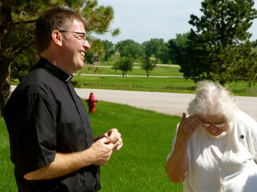 Fr. Mark McCormick and Sister Florence share in conversation