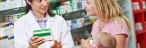 pharmacist explaining medication to new mother
