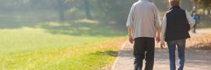 Man and woman walking on path