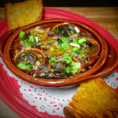 ESCARGOT - baked in garlic butter green onions and topped with Asiago cheese