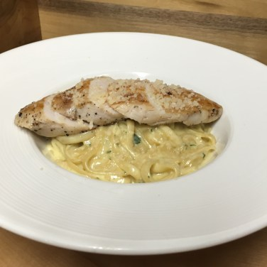 CHICKEN FETTUCCINE ALFREDO - Fettuccine pasted in a mild Asiago craem sauce, topped with chicken