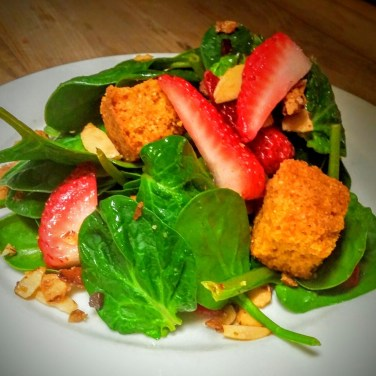 SPINACH SALAD - Baby spinach with strawberries, candied almonds, and house made cornbread croutons tossed with our bacon vinaigrette. Include