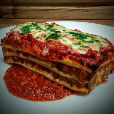 LASAGNA - House Made pasta sheets with spiced ground sirloin Italian sausage, ricotta, Asiago, and mozzarella cheeses