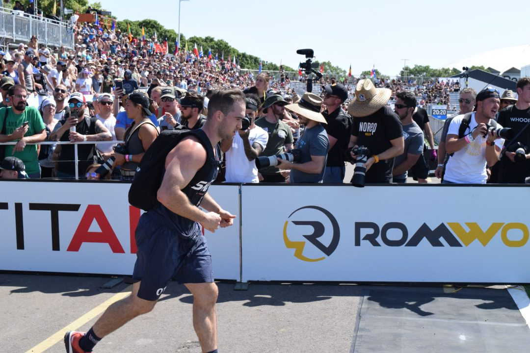 Ben Smith of the United States completes the Ruck Run event at the 2019 CrossFit Games