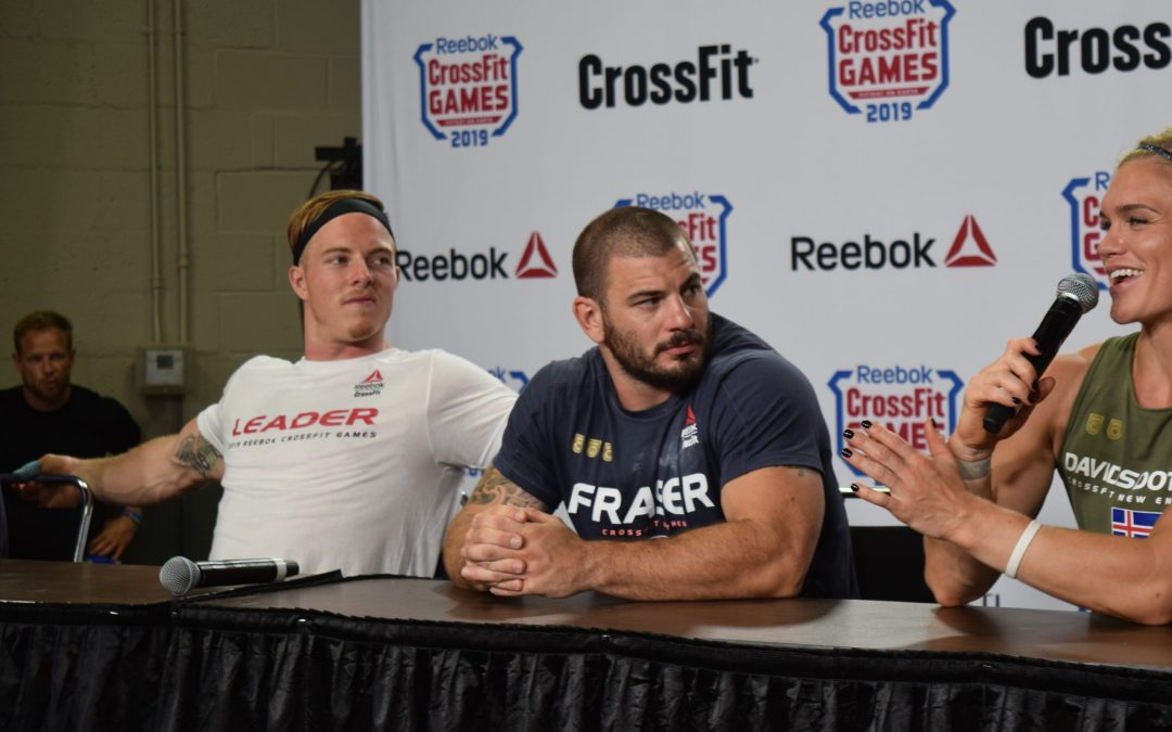 Noah Ohlsen in the leader's jersey with Mat Fraser during one of the end-of-day press conferences at the 2019 CrossFit Games.