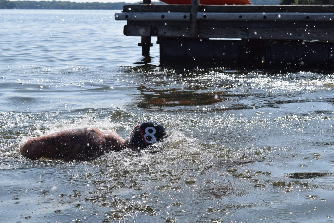 Matt Mcleod and Tia-Clair Toomey in the last leg of the swim in the Swim Paddle event at the 2019 CrossFit Games