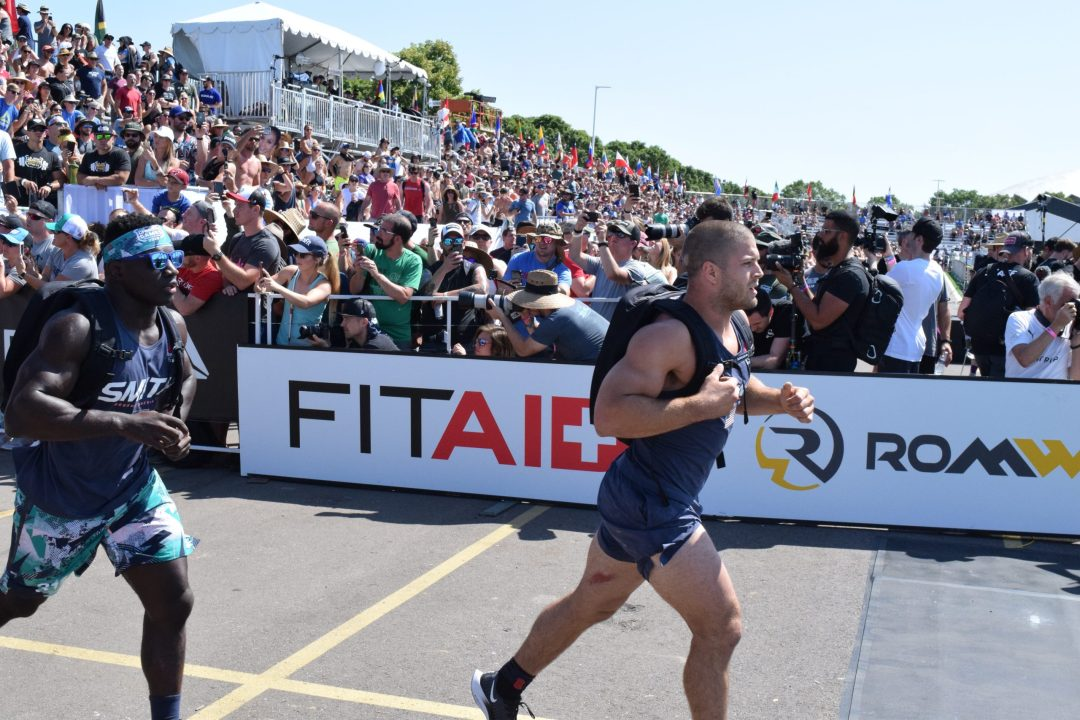 Chandler Smith chases down Jacob Heppner in the Ruck Run event at the 2019 CrossFit Games.