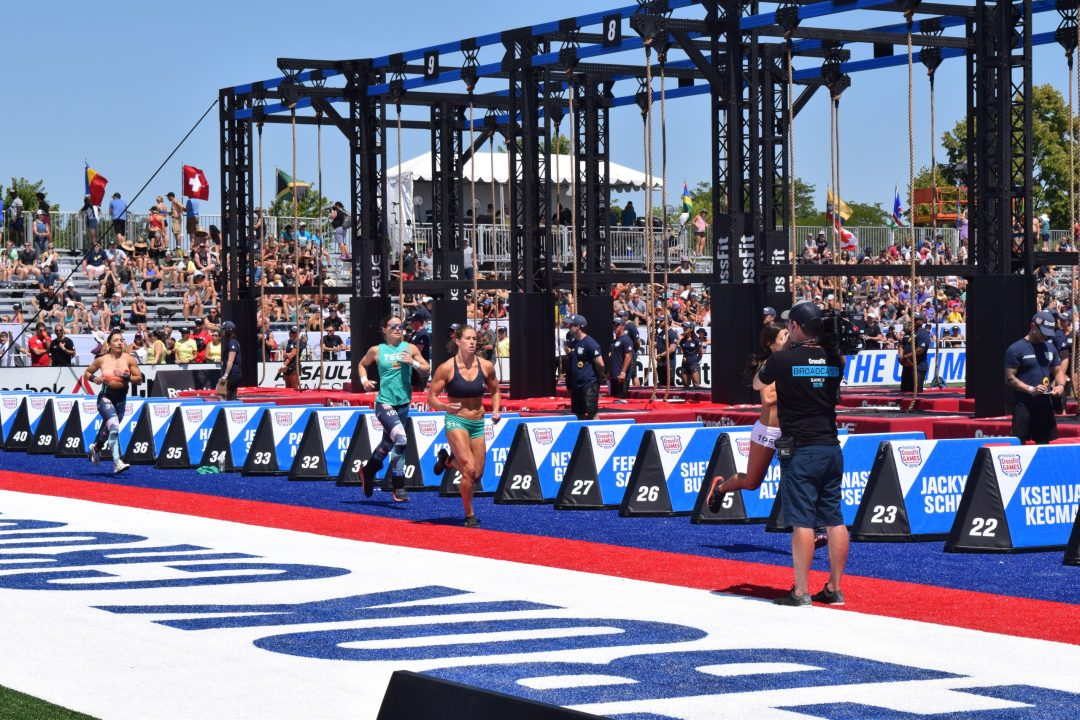 Emily Rolfe takes a lap between rounds of legless rope climbs at the 2019 CrossFit Games
