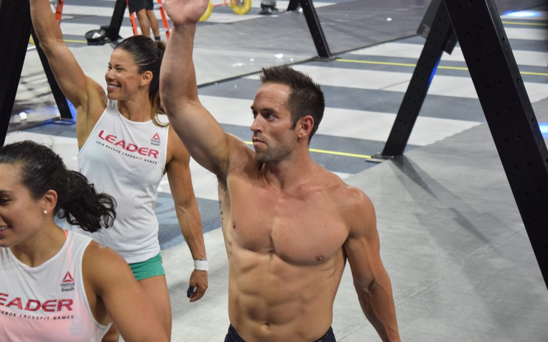 Rich Froning waves from the Coliseum floor after Mayhem Freedom won the 2019 CrossFit Games.