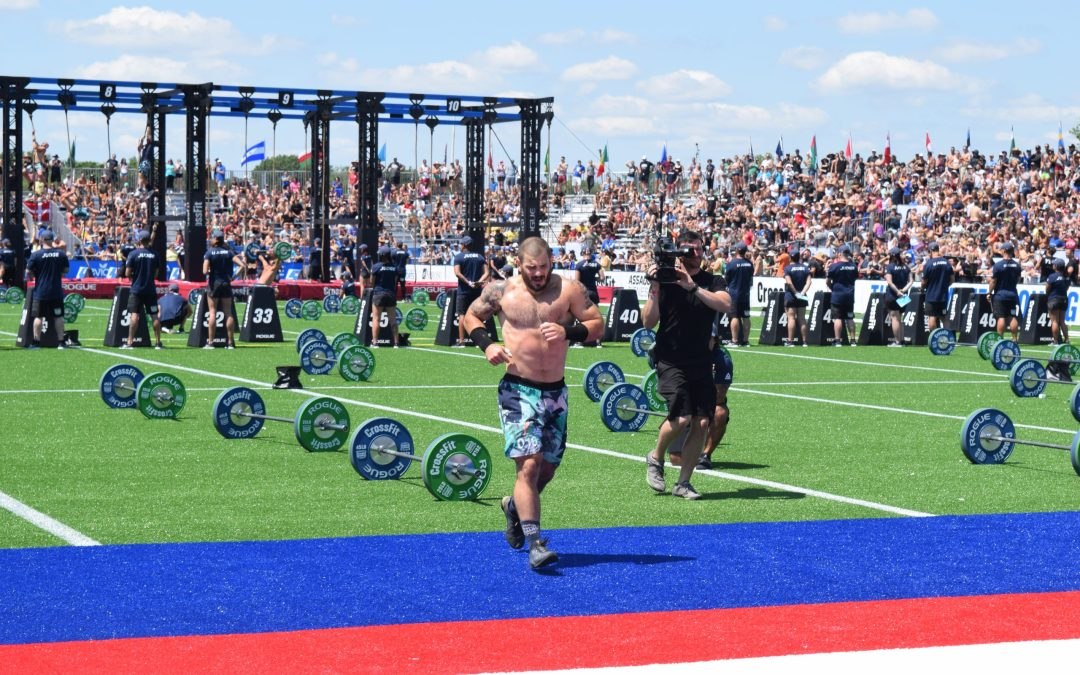 Mat Fraser crosses the finish line of the Second Cut event at the 2019 CrossFit Games