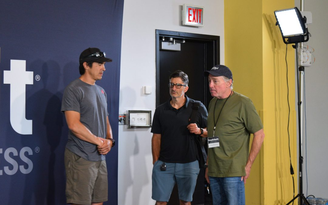 Greg Glassman, Sevan Matossian, and Dave Castro talk before a press conference at the 2019 CrossFit Games