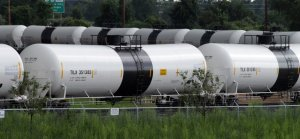 Railroad tank cars are unloaded on a loop track at a refinery in Delaware City, Delaware.   Curtis Tate / MCT