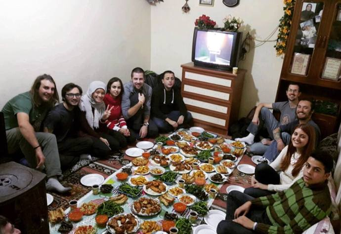 ReVI volunteers enjoying a weekly dinner with a Syrian refugee family