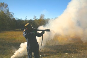 Firing a Tear Gas launcher while training with the RCMP