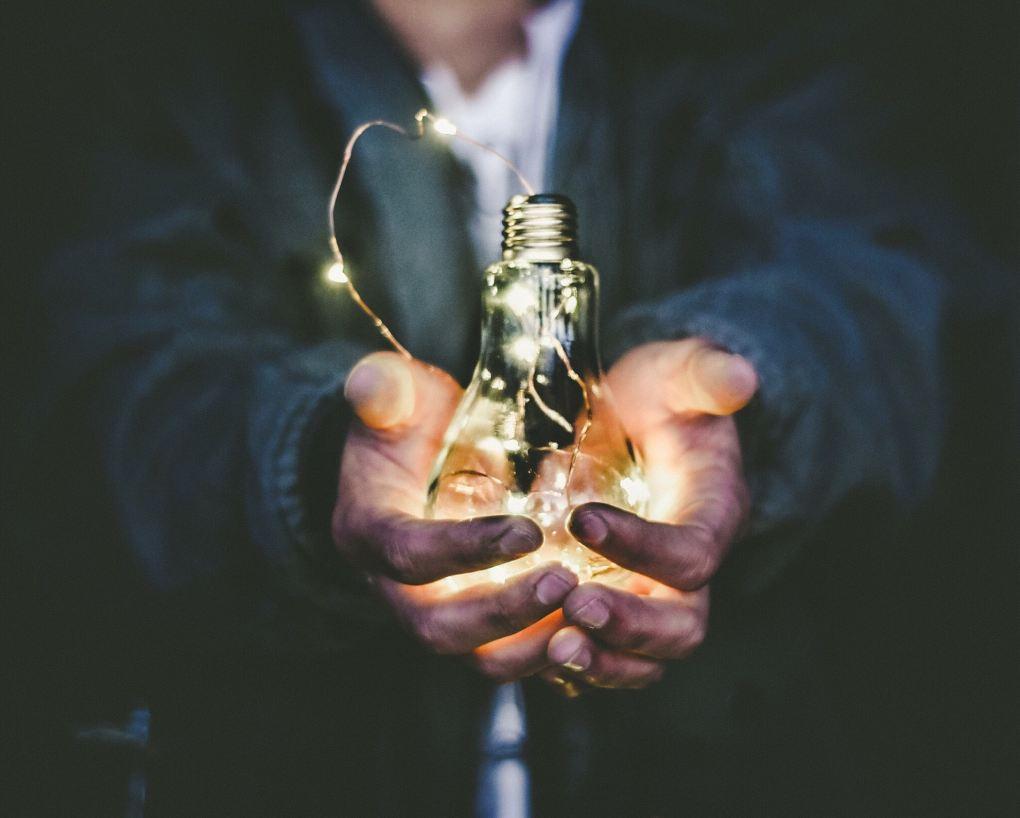 Man holding lights