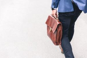 Man with suitcase walking away on Benjamin Preston's website
