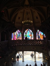 Stain glass windows line the interior.