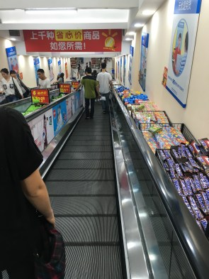 This is actually from my second trip to 沃尔玛。I didn't get a proper picture of it the first time, but this is how you move between the two floors! Downstairs is all food and checkout and upstairs is pretty much everything else you would find at Walmart.