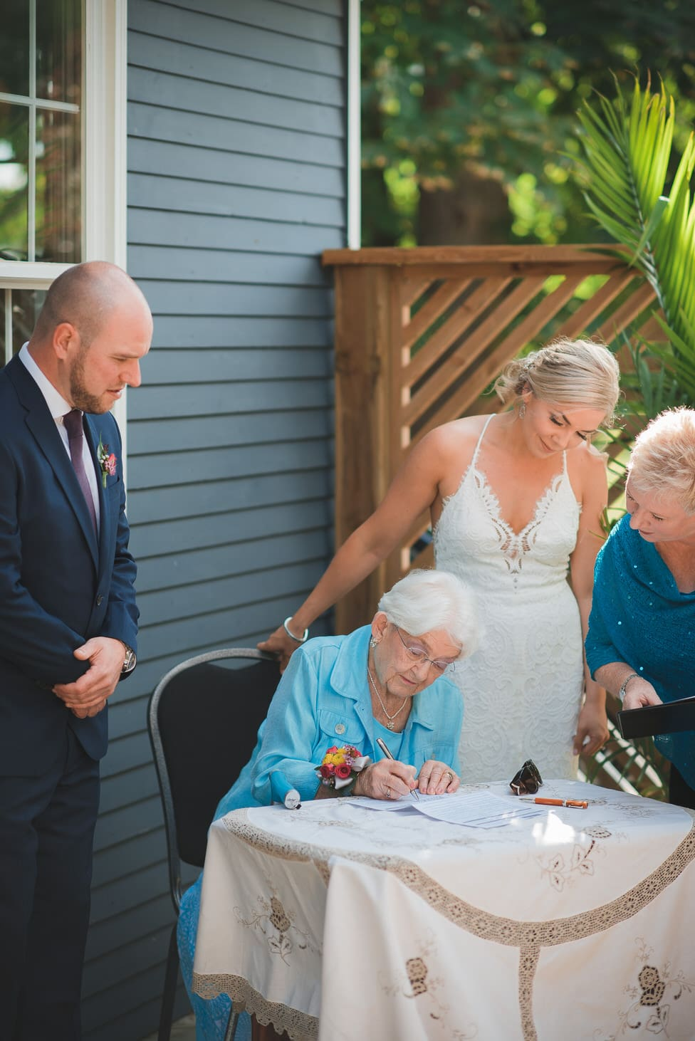 grandmother of the groom signs marriage register