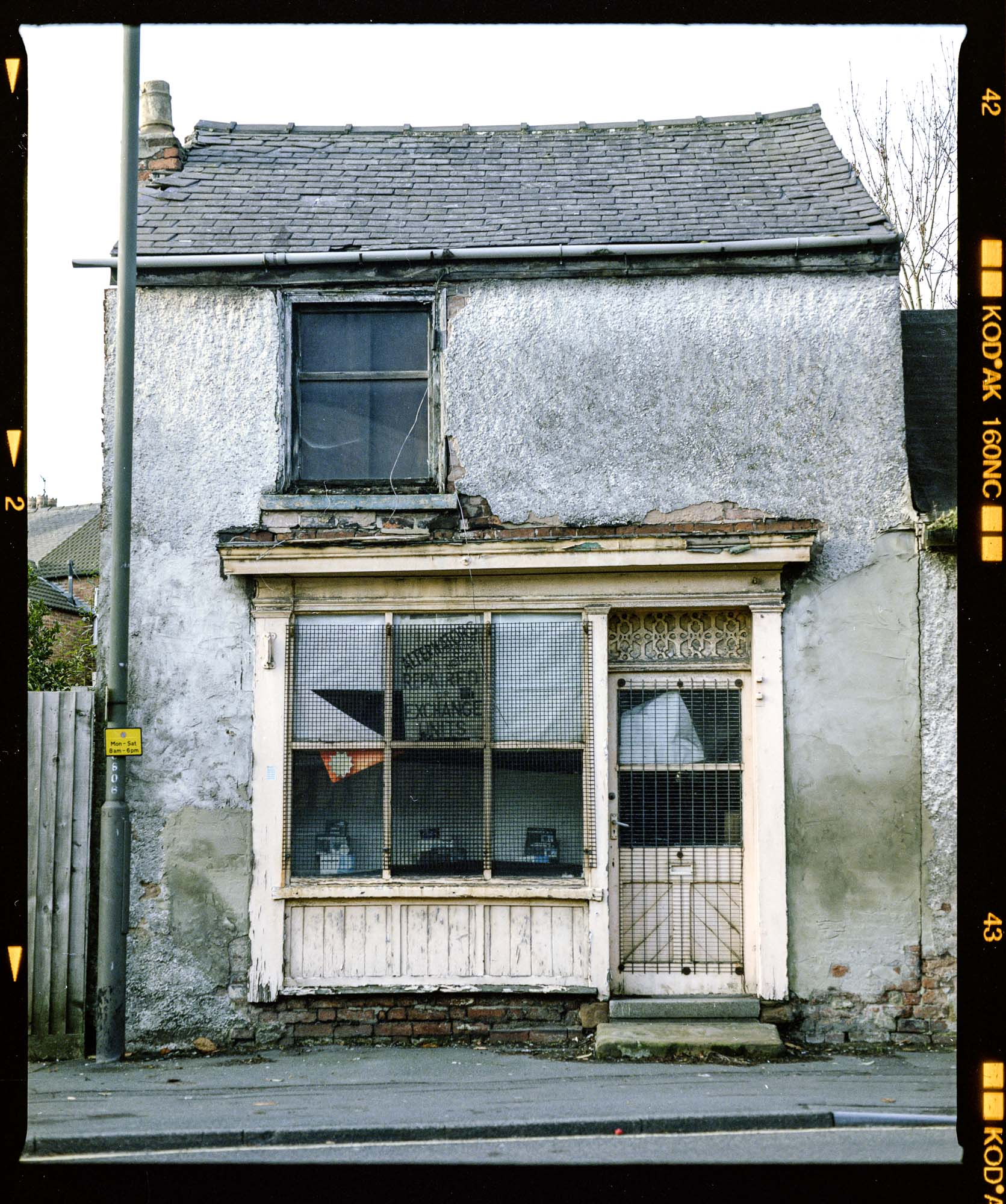 derelict shop shot on a Mamiya RB67 and kodak portra 160nc 120 film, ilkeston, derbyshire