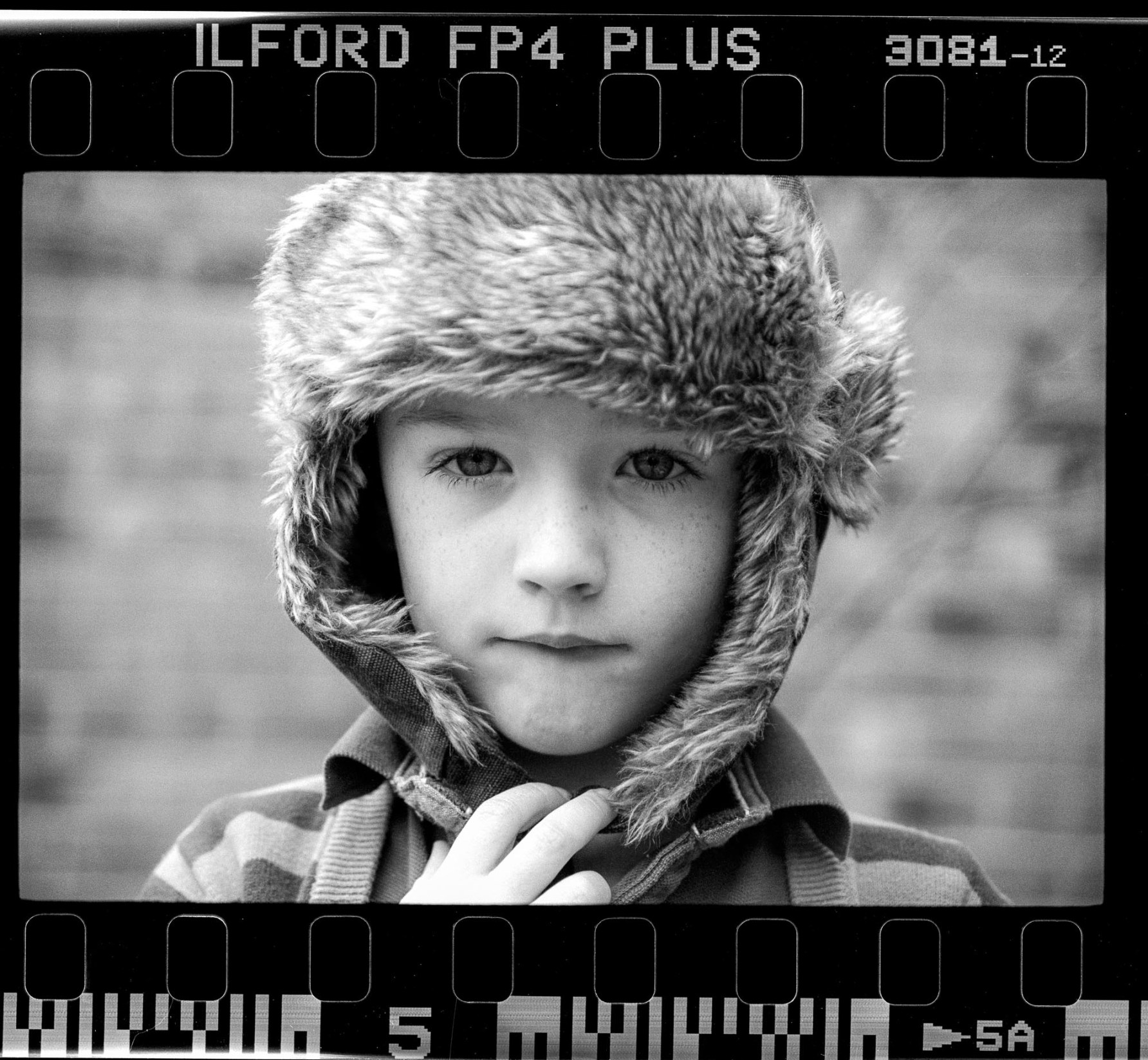 black and white portrait shot on 35mm ilford fp4 plus film