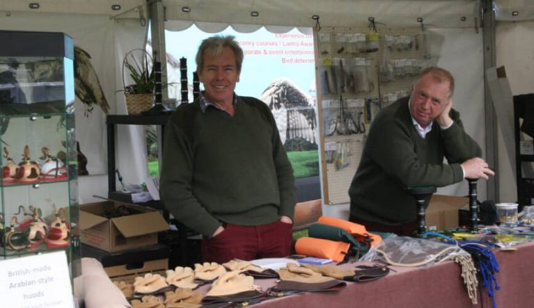 ben long in his falconry stall at a falconry fair