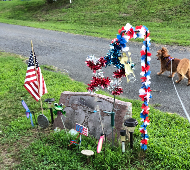 a decorated gravesite in the local cemetery