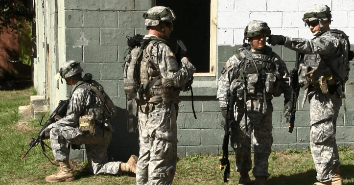 In October 2015, Soldiers from 3rd Brigade, 3rd Infantry Division, take enemy fire as they prepare to enter and clear a building during the live training McKenna Urban Operations Complex at Fort Benning.