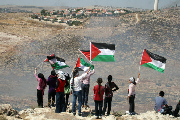 Palestinians protest against the expansion of a nearby Israeli settlement. CREDIT: Issam Rimawi / APA images