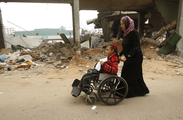 A mother and her daughter in Gaza on their way to a demonstration on the 2012 UN International Day of People with Disability. CREDIT: AFP / Getty Images / Mohammed Abed