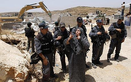 A Palestinian home demolition in East Jerusalem  CREDIT: Reuters