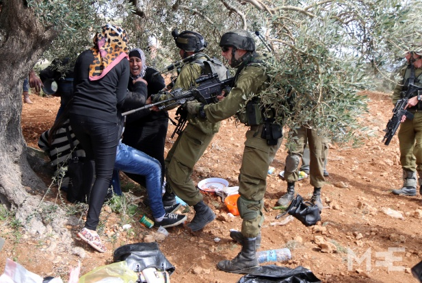 Israeli soldiers violently break up a West Bank protest commemorating the death of Rachel Corrie CREDIT: Middle East Eye/Ahmad Al-Bazz