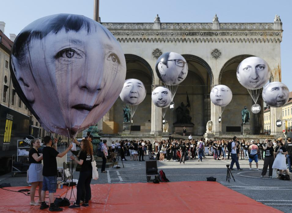 Balloons made by the 'ONE' campaigning organisation depicting leaders of the countries members of the G7 are pictured in Munich
