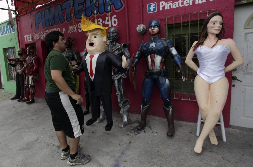 Mexican artist Dalton Javier Avalos Ramirez with his Donald Trump piñata
