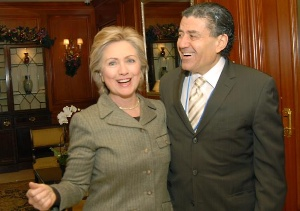 Hillary Clinton embracing Israeli-American billionaire Haim Saban, the 497th-richest man in the world