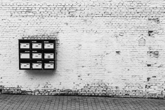 postbox composition on a white wall