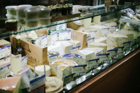Hard cheese at a deli