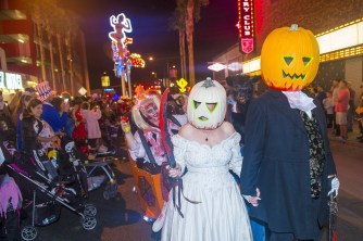 Couple in pumpkin head costumes in Downtown Las Vegas